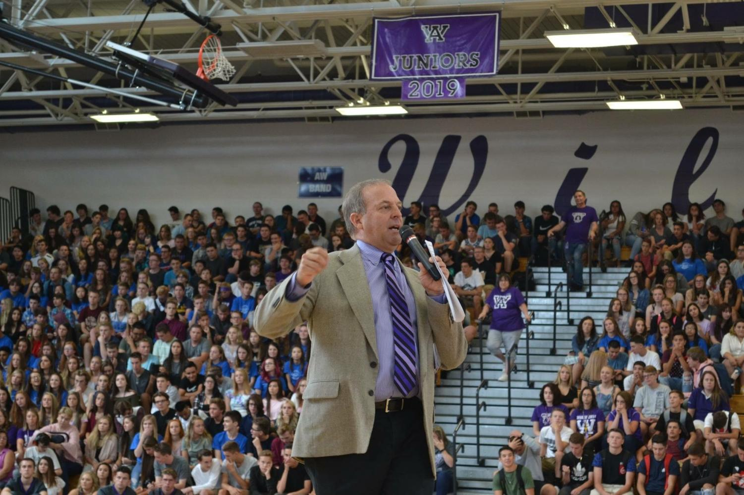 Bishop speaks at the back to school assembly on the first day of the 2017-18 school year, his last as A-West principal.