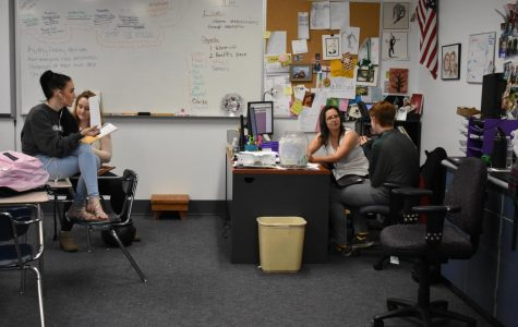 A-West English teacher Angela Dryer talks with students.