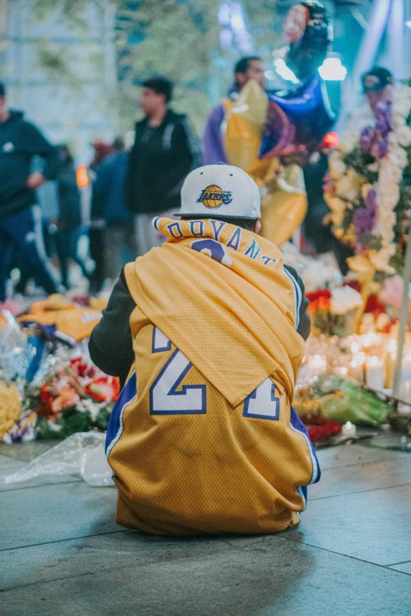 Kobe Bryant fan morns the death of his idol at a memorial. Photo courtesy of Fred Kearney on Unsplash.com.