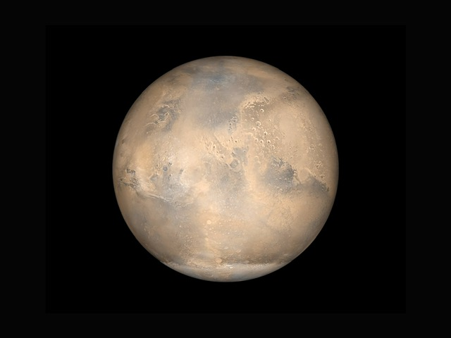 A simulated view of Mars as it would be seen from Mars Global Surveyor spacecraft.. Photo courtesy of NASA on Unsplash