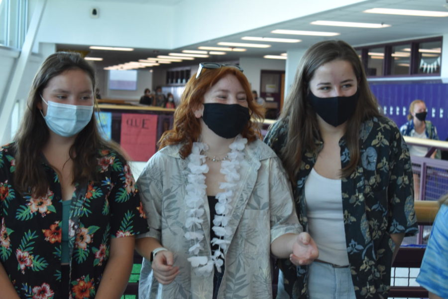 Val Johnson, Kalissa Martinez, Grace Cochran pose to defend their squad against bikers in a spirit day surf and turf war.