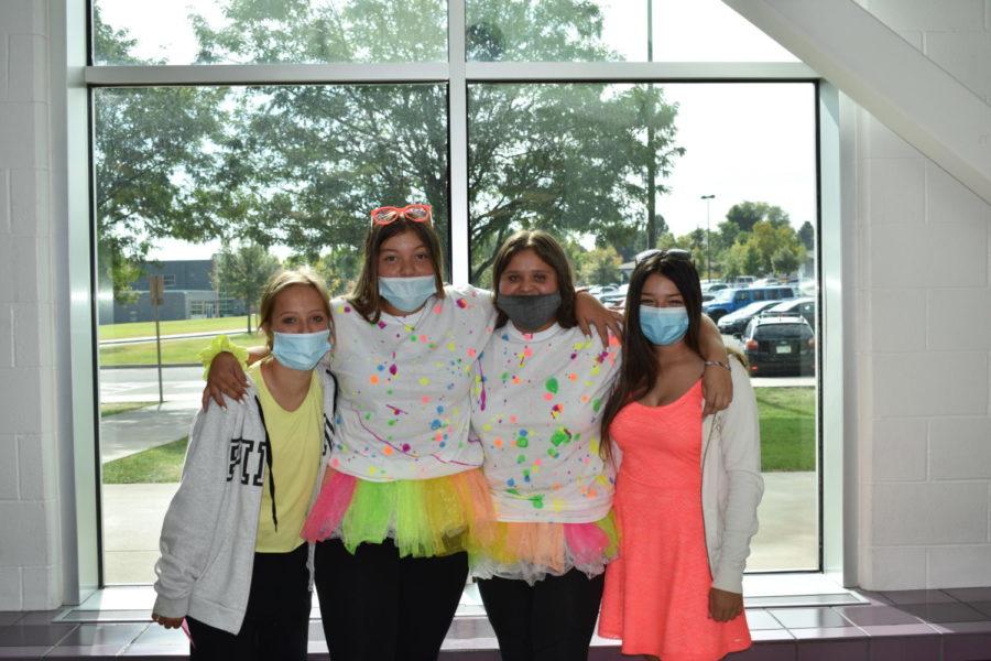 Students pose to showcase their Neon Day spirit wear.