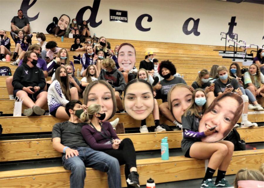 A-West fans gather on Tuesday night with giant posters to celebrate the seniors at the varsity girls volleyball game.